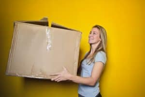 Girl Getting ready for her move by packing